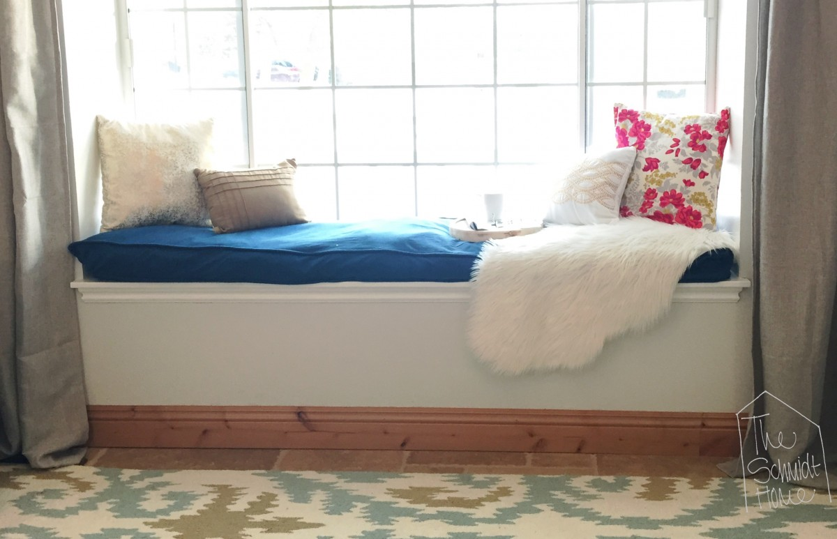 Make a bench cushion using a doggie bed! A fraction of the cost of foam, and much more comfortable looking!