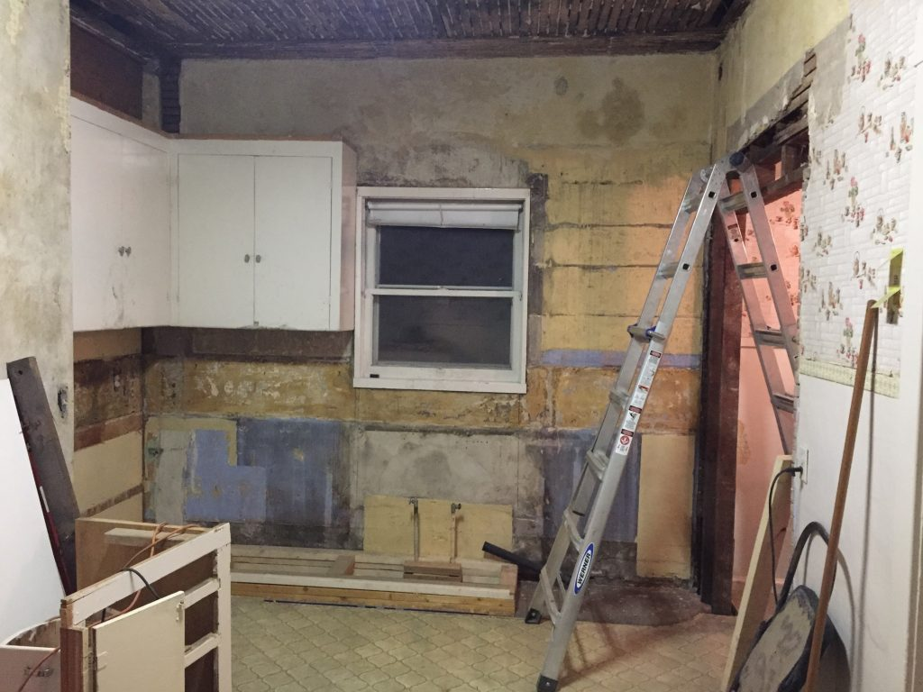 1916 Home renovations, kitchen with 2 upper cabinets raised and repaired